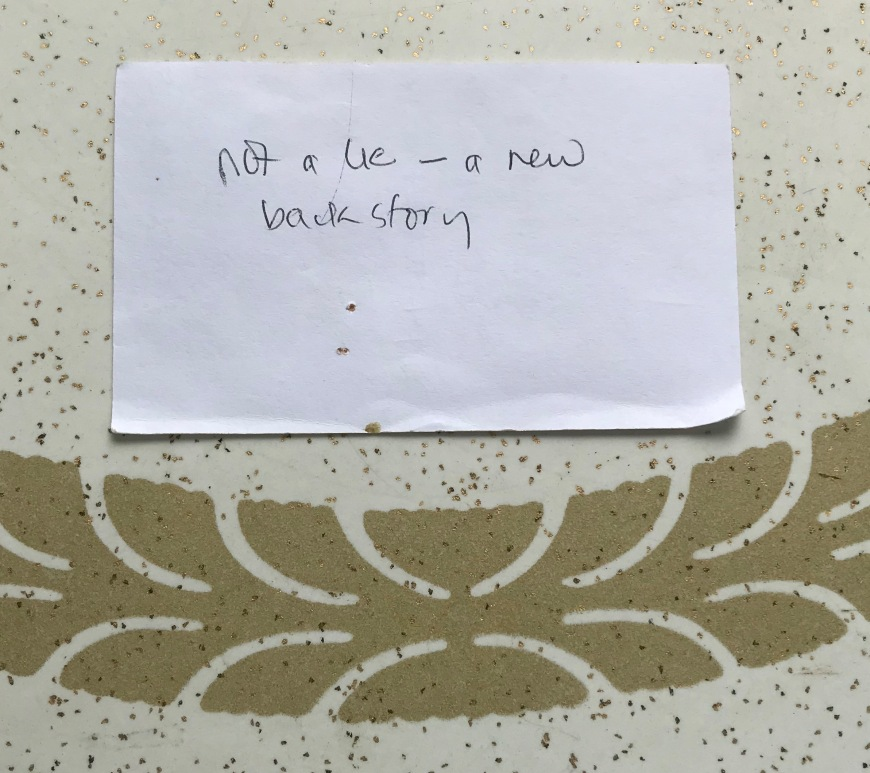 """The comment """"not a lie - a new backstory"""" written onto an unlined 5x7 note card."""